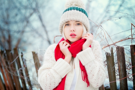 Winter blonde Woman portrait. Beautiful fashion model girl in bright hat and scarf Stock Photo - 17467002