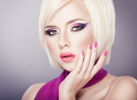 Beautiful woman with bright violet purple makeup, lips and manicure Stock Photo - 17625974