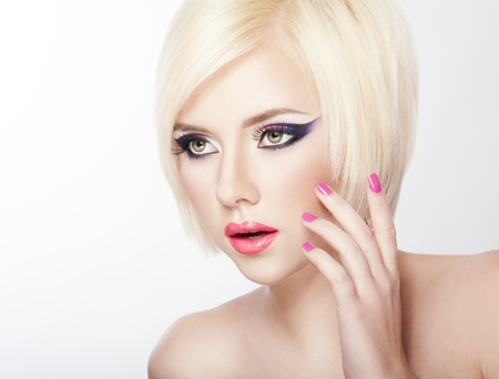 Beautiful woman with short Blond hair, bright violet purple makeup, lips and manicure Stock Photo