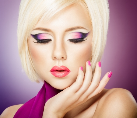 Beautiful woman with bright violet purple makeup, lips and manicure