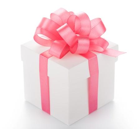 White box with pink ribbon on white background Stock Photo
