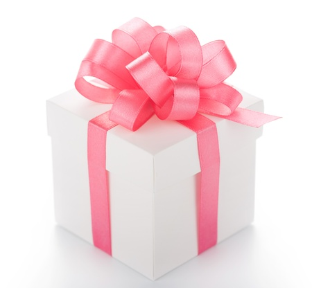 White box with pink ribbon on white background Stock Photo
