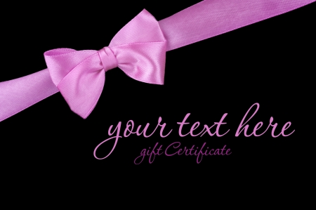 marriage certificate: Pink ribbon bow on black background Stock Photo