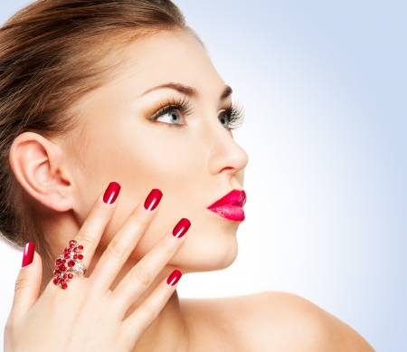 Woman with bright red lips and manicure photo