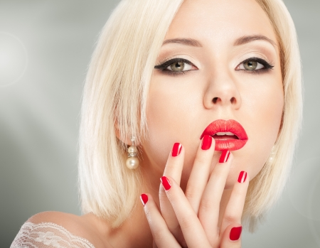 Blonde woman with bright red lips and manicure Stock Photo - 19098237