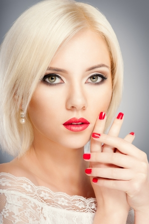 Blonde woman with bright red lips and manicure Stock Photo - 19502025