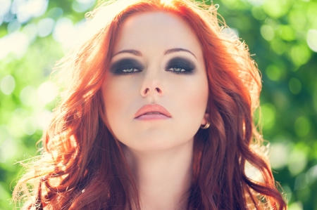 smoky: Summer portrait of beautiful woman with red hair and smoky eyes makeup