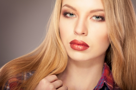 Blonde beautiful woman with bright red lips Stock Photo - 24365141