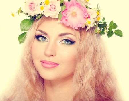 beautiful woman with bright makeup and blonde long hair, with flowers