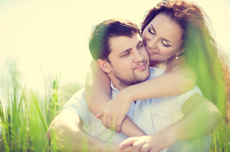 tenderly: beautiful couple in love tenderly embraces outdoor