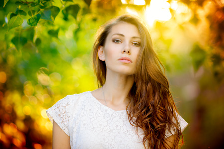 Outdoors summer portrait of beautiful woman, sunset