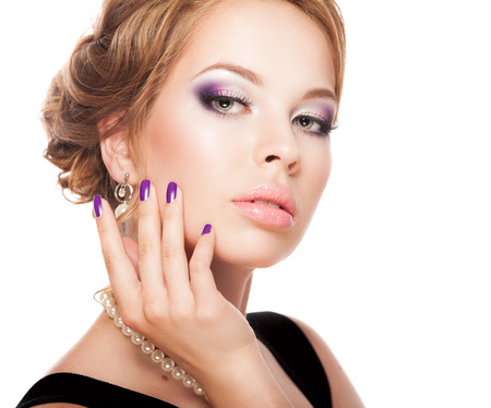 Beautiful woman face with bright makeup and manicure photo