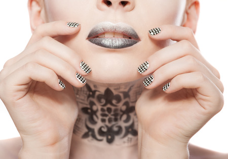 beautiful woman with bright black lips and manicure photo