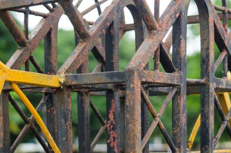 obsolescence: Rusty iron fence Stock Photo