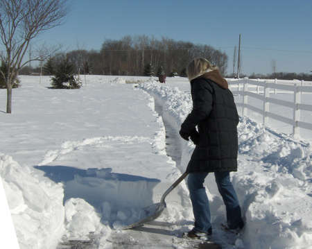 clearing driveway of snow
