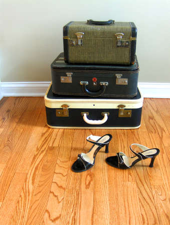 vintage suitcase with womens shoes Stock Photo