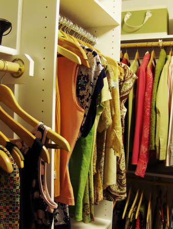 colorful clothes in womens closet