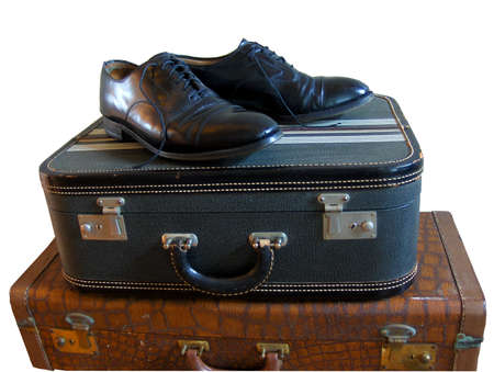 mens dress shoes atop vintage luggage Stock Photo