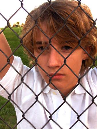 Boy on the outside Reklamní fotografie