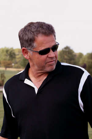 middle aged man in golf shirt