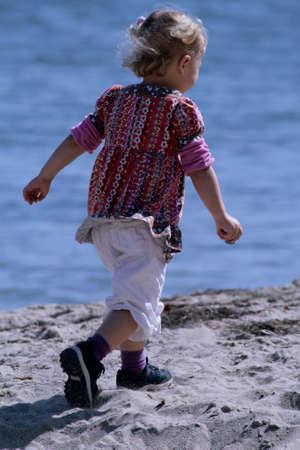 little blonde girl at beach