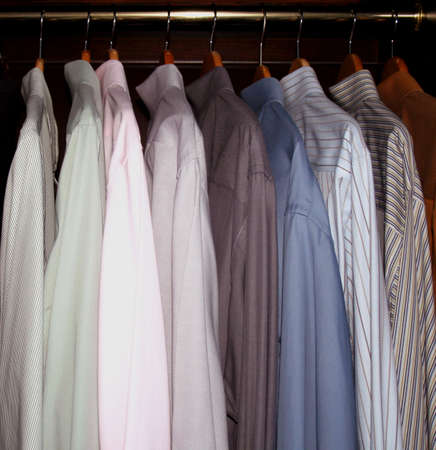 mens dress shirts hanging in wardrobe closet