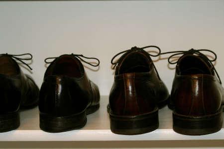 mens dress shoes on shoe shelf in closet