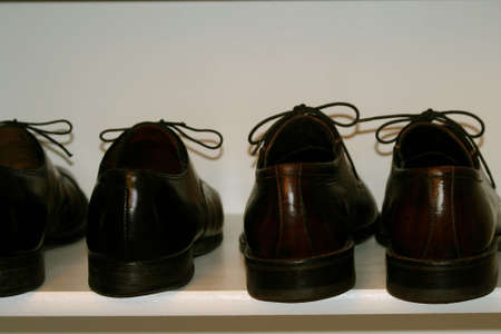 mens dress shoes on shoe shelf in closet