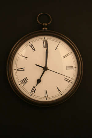 bronze pocketwatch style clock at 7 oclock
