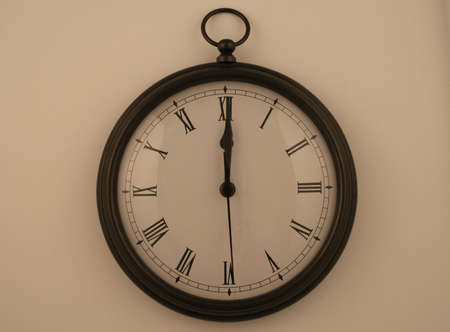 pocketwatch style clock reading midnight