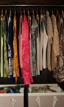 blouses and scarves in wardrobe closet