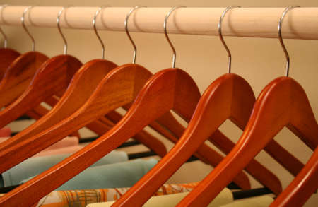 neat row of matching wooden hangers
