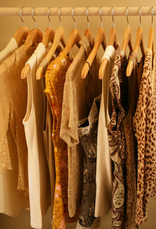 closeup shot of womens blouses on hangers Stock Photo