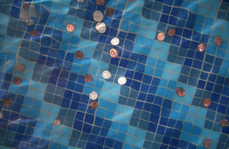 coins tossed in a fountain