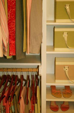 neatly organized womens closet photo