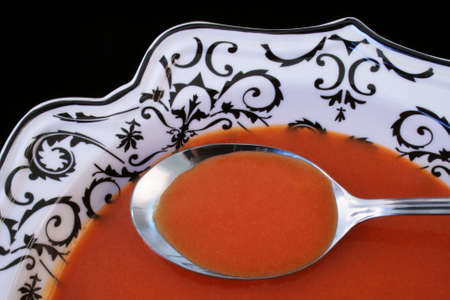 tomato soup on a spoon in fancy black and white dish Stock Photo - 3633310