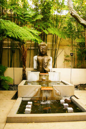 exotic eastern spiritual statue in fountain