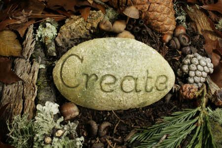 the word create on stone in forest Stock Photo