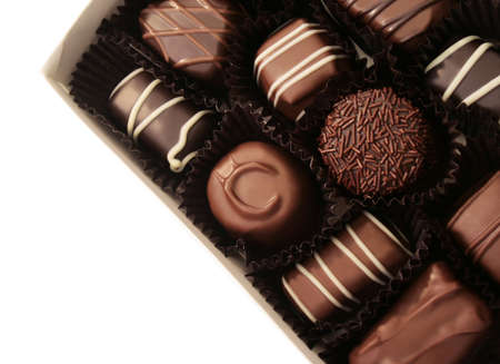 box of assorted chocolates on white background
