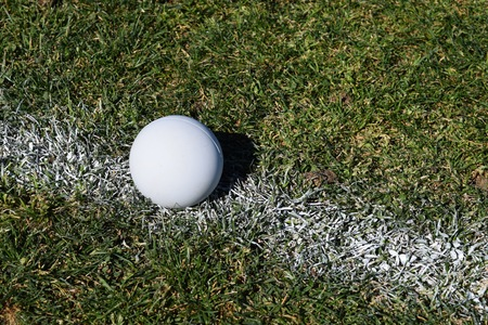 Lacrosse ball on center stripe Stock Photo