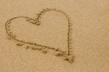 heart shape drawn into the sand photo