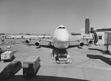 towed: airplane being towed at Narita airport in Japan