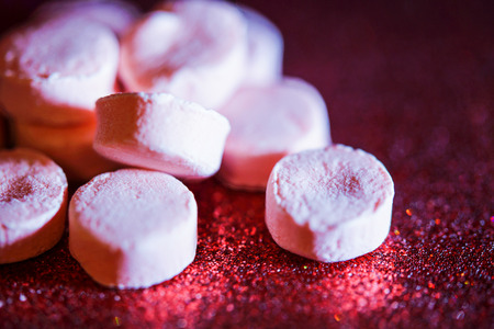 sparkly: Cinnamon candies on sparkly red surface