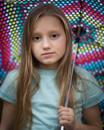 Portrait Of A Shy Young Child Girl With Long Dark Blond Hair Wearing