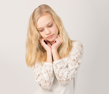 fresh girl: Studio portrait of a beautiful blond teenage girl with long hair and blue eyes isolated against a white background.