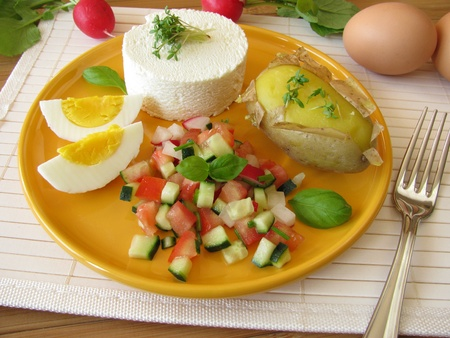 Goat cream cheeses with salad, potato and egg Stock Photo - 9926262