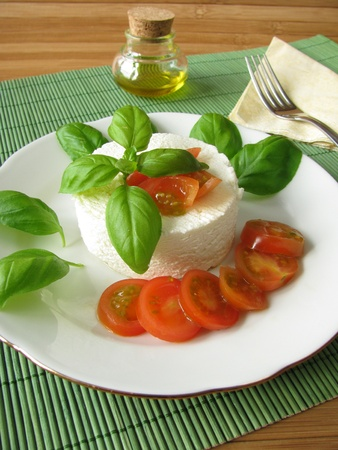 Goat cream cheese with tomatoes and basil photo