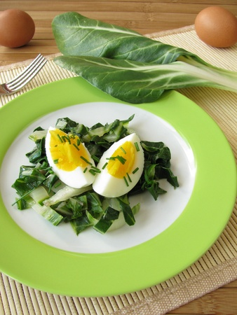 chard: Eggs on chard vegetables Stock Photo