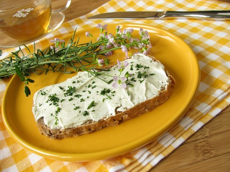 Herb curd with Cuckoo Flower on bread photo
