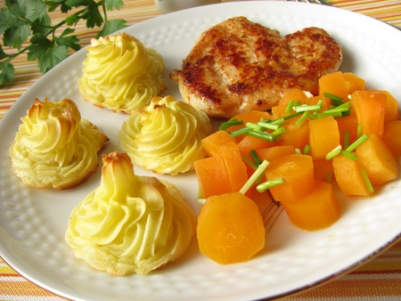 stewed: Chicken with stewed carrots and dutchess potatoes Stock Photo